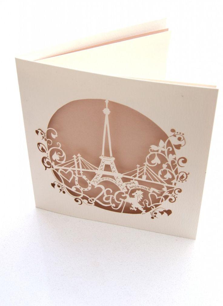 Eiffel tower inspired laser cut wedding invitations.