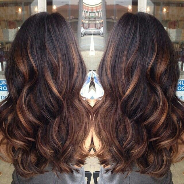 Dark brown hair with  golden caramel lights!