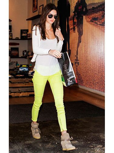 Bright Idea Amp up your jeans style with a pop of neon! Kendall balances her electric yellow pants with a crisp white tee and cardi and wedg...