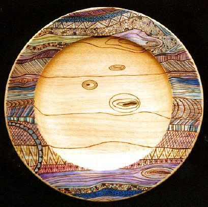Pyrography and acrylic ink on rubberwood platter.  Decoration by Sue Burne.