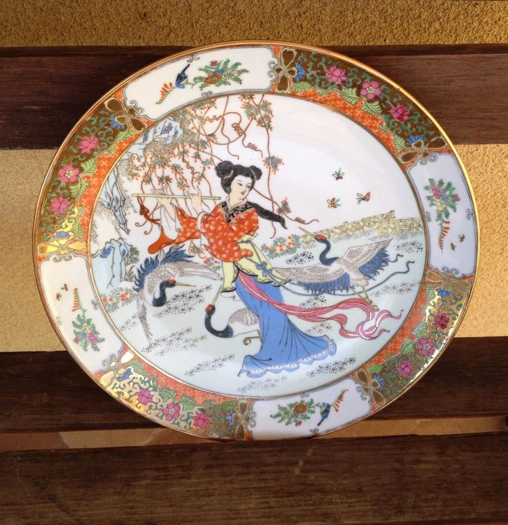 A personal favorite from my Etsy shop https://www.etsy.com/listing/225745115/geisha-asian-collectible-plate-geisha