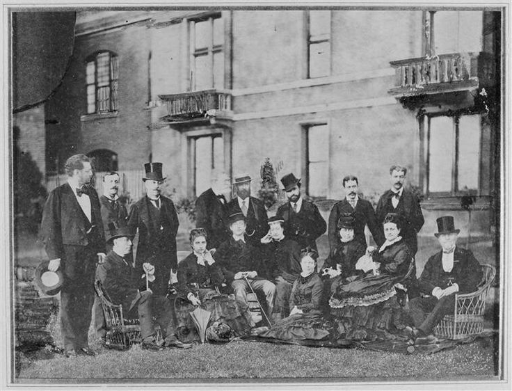 Empress Eugenie with the Prince Imperial in a group in front of Camden Place - 1874