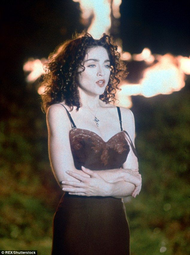 Cross theme: Madonna previoulsy embraced the cross theme in her 1989 music video for Like A Prayer