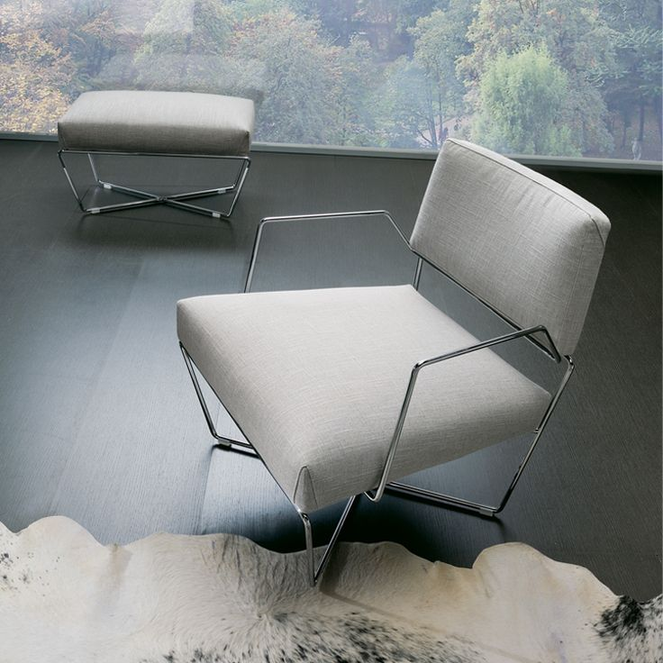 The Sandy is an elegant, compact chair available with or without arms, in fabric or leather, and with optional ottoman.