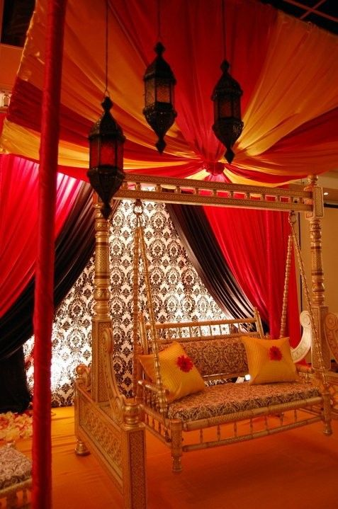 Indoor swing!  Wow, all the fabric and those lovely Moroccan lamps!