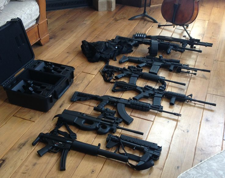 My music of the apocalypse... Top to bottom;  Remington 870 Wingmaster Tactical Mod, Saiga 12 with 20 round drum mag., FN Herstal SCAR 17S .308 with Molon Labe 25 round mag and SWFA 10x42 Optic, Sig Sauer M400 AR-15, LMT AR-15, Aimpoint Micro T-1, Slide Fire SSAR,  and FN P90 , AK - 47, Kel-Tec Sub 2000 .40 S&W, and H&K mp5.   Case; H&K USP 9 mm, Springfield XD SC Crimson Trace grip laser, .40 S&W, Springfield XDs .45 SC, Glock 22 .40 S&W, Beretta Px4 Storm Subcompact.    Let the games…