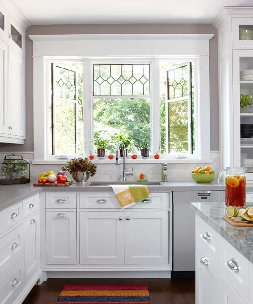 Leaded-glass windows, bin-pull hardware, and marble  backsplash create a vintage look in a contemporary way.   | Photo: Stacey Brandford | thisoldhouse.com