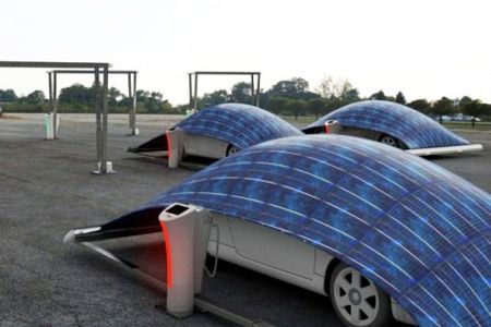 V-tent solar powered charging station for electric vehicles - find more cool designs here http://www.mysolarquotes.co.nz/blog/future-of-solar-power/the-coolest-solar-power-car-charging-station-designs