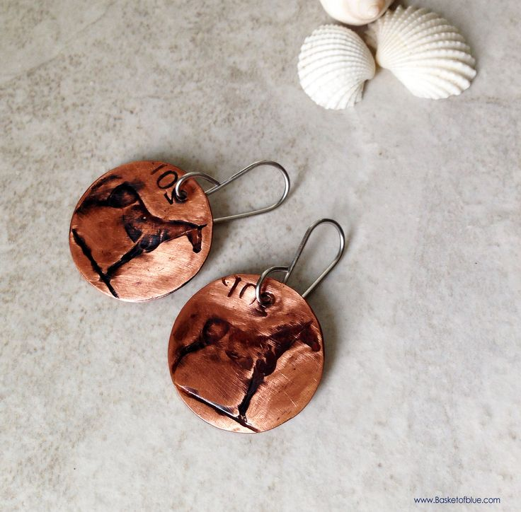 Copper patina coin earrings, vintage European coin embossed circle disc, Irish 20 pence coin with a horse, hand hammered onto pure copper. It features the horse (an Irish hunter) that was on the pr…