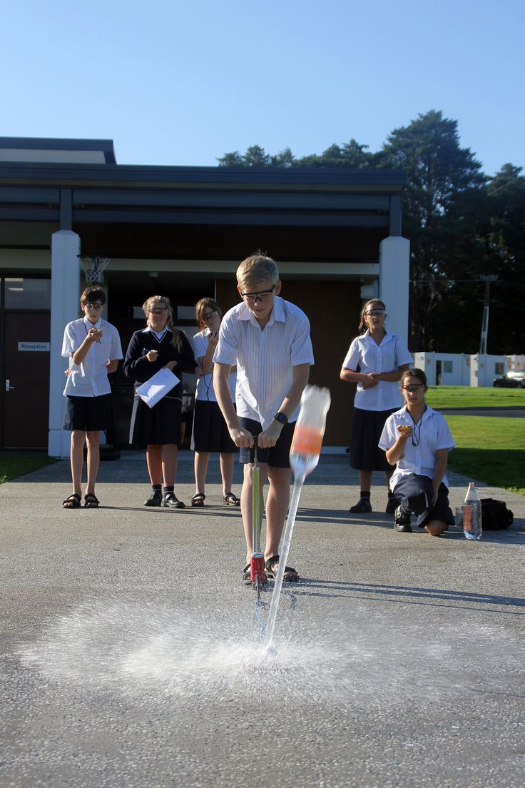 Students learning how the volume of water in the water rocket affects its flight.