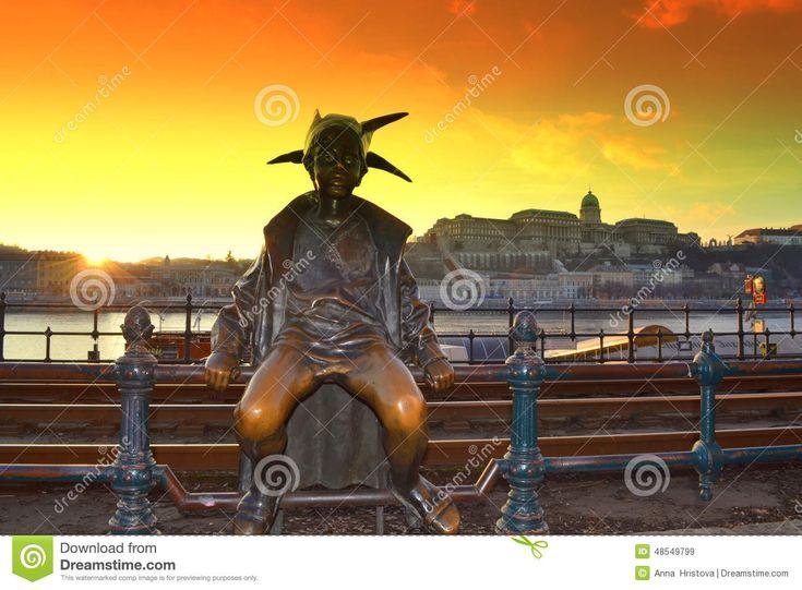 Little Princess statue,railroad,Buda Castle and bright yellow sunset skies Budapest Hungary