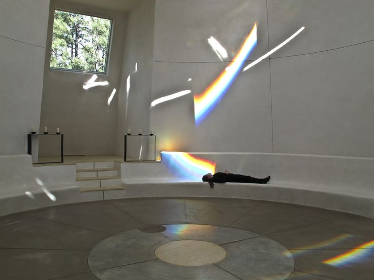 A futuristic temple of light uses prisms and rainbows to create an atmosphere of peace.