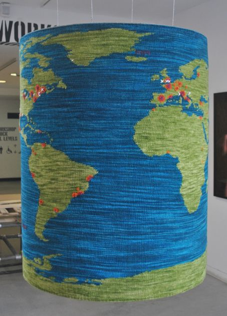 hand knit world map, demonstrating through color where it is best to be an artist, where grants for the arts are plentiful and a dynamic artistic community thrives.