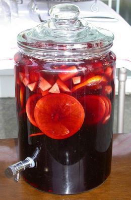 Sangria. 'Sangria (Spanish: Sangría) is a wine punch typical of Argentina, Spain and Portugal. It normally consists of wine, chopped fruit, a sweetener, and a small amount of added brandy. In the case of fruits, they are chopped or sliced such as orange, lemon, lime, apple, peach, melon, berries, pineapple, grape, kiwi and mango. A sweetener such as honey, sugar, simple syrup, orange juice is added. Instead of brandy.' http://www.lonelyplanet.com/spain