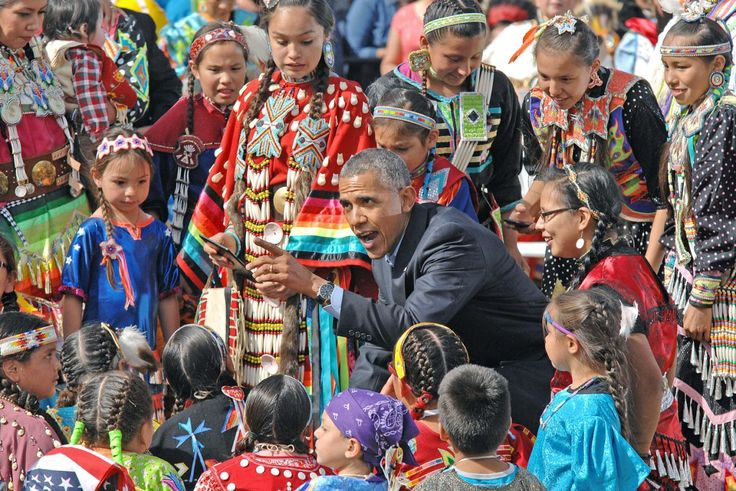 President Barack Obama visits with Native American youngsters during his visit to Cannon Ball, N.D., Friday, June 13, 2014. (AP Photo/Bismarck Tribune, Tom Stromme)