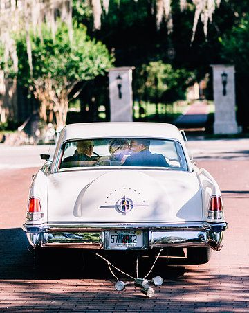 heading out after the reception in a vintage car on this sunny spring wedding day!