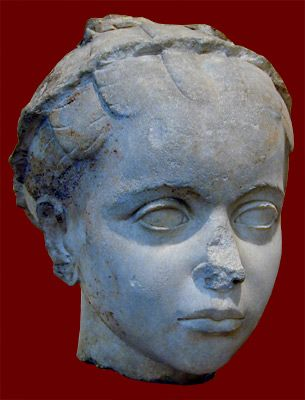 Portrait Head of a young girl, wearing a rolled ribbon in her hair, a sign that she was a priestess, despite her young age. Roman, from Greece (probably Corinth), 100-140 CE. Boston, Museum of Fine Arts.