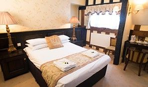 One of the stunning bedrooms at the Tudor House Hotel