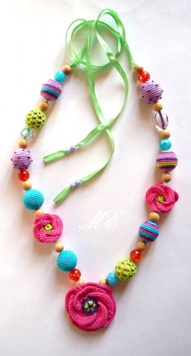 "cute necklace! Joyce Lewis says, ""I see so many beautiful and colorful beads in Michaels and Hobby Lobby, that you can string yourself....I wonder if we could duplicate this cute necklace?"""