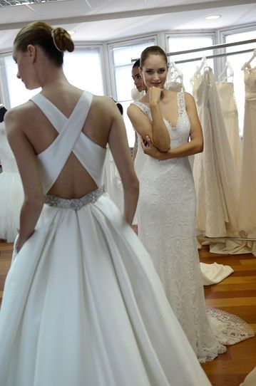 Update a traditional dress shape with cross-over straps, like Rosa Clara did.