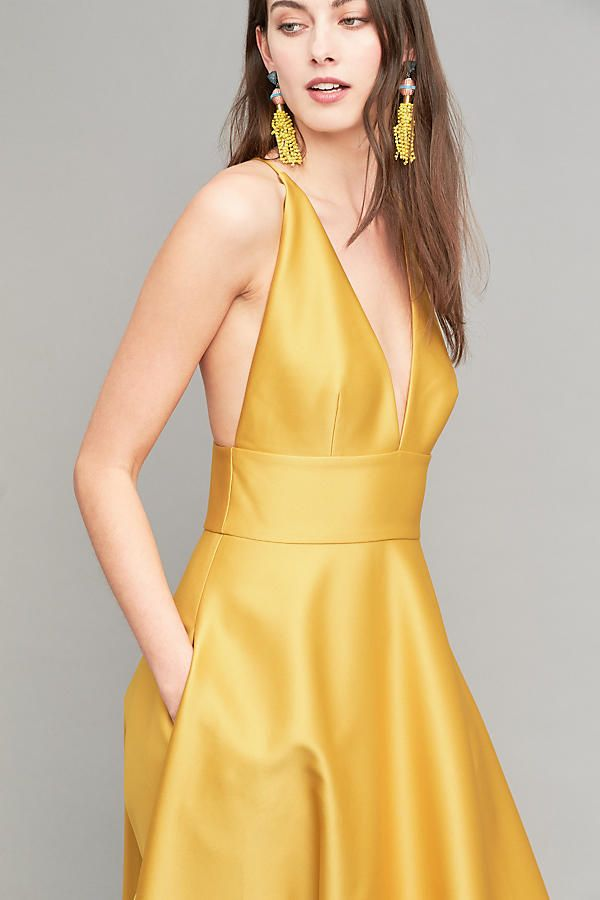 Crafted from satin and in a golden hue, this halter Venice dress is sleek  and