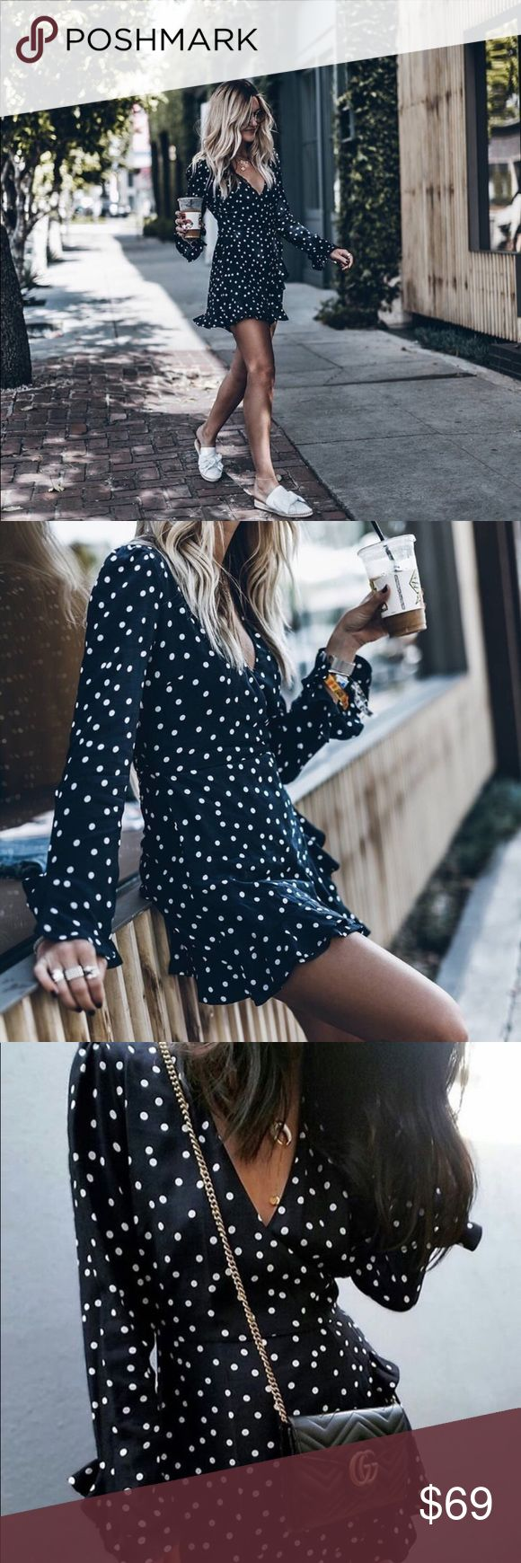Zara Navy Polka Dot Romper small blogger favorite Worn twice, in great condition. Long sleeve with wrap front. Seriously so cute on! Only parting with it because the two times I wore it, I had lots of pictures so, you know how that goes. Size small. Runs true to size Zara Pants Jumpsuits & Rompers