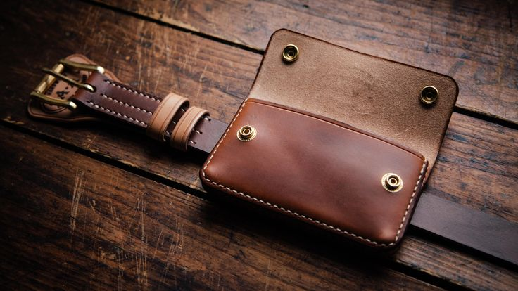 Set in a vintage style. Leather wallet , belt and bag for phone
