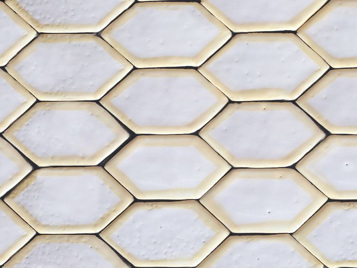 Handmade hexagon ceramic tiles in white with yellow borders