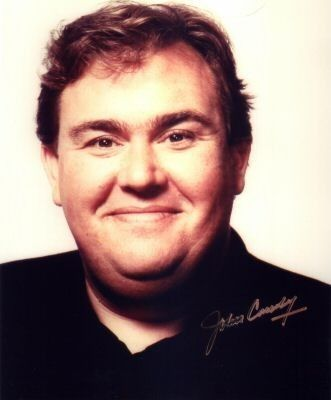 """John Candy, who was an amazing actor. Appeared in such excellent films as Planes, Trains and Automobiles. """"Those aren't pillows!"""" And Spaceballs. And The Great Outdoors. And he was in Home Alone, too.  His final movie, """"Canadian Bacon"""" was actually pretty thought-provoking, about a US president who decides to start a war with Canada. """"Surrender pronto, or we'll level Toronto!"""""""