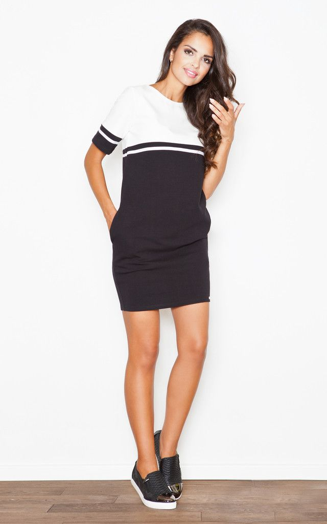 Stylish ecru and black bubble dress with side pockets. A young and fun design, great for day or night. Pair it with tights and boots or some classy heels. Shop now.