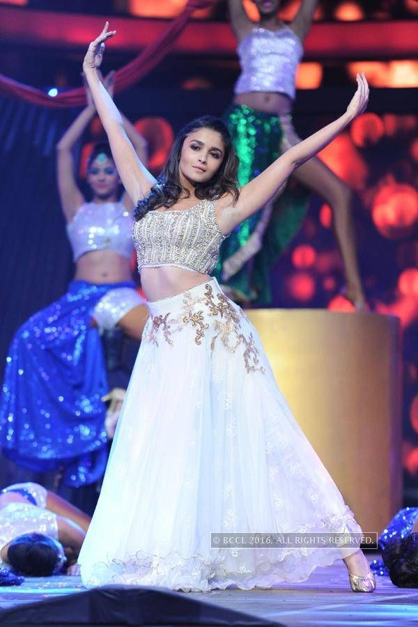 Actor Alia Bhatt charmed with her look of a crop top and embroidered pastel lehenga on stage.