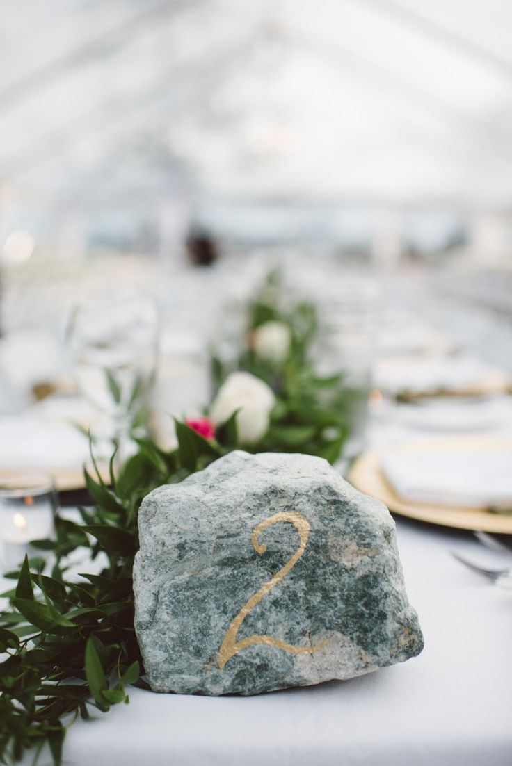 Stone wedding table decor: Photography: Whitney Krutzfeldt Photography - wckphotography.com Read More on SMP: http://www.stylemepretty.com/2016/01/15/outdoor-british-columbia-wedding-with-a-two-piece-dress/