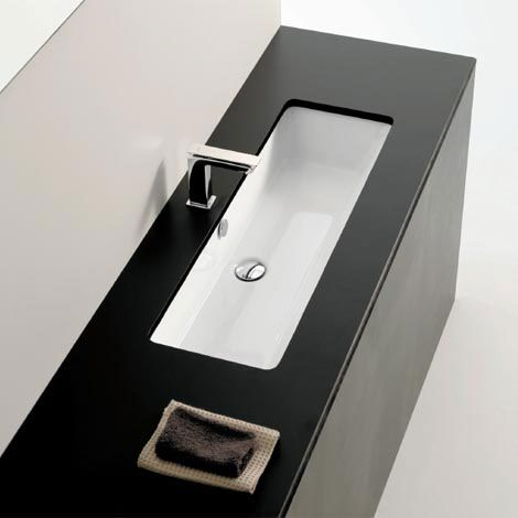 A rectangular shaped basin with sloping front and sides. The Box 90 undercounter has been designed to match the above counter or semi recessed versions, or the No More Fights basins.