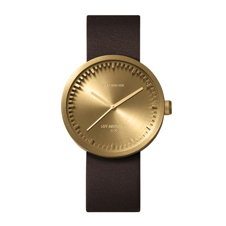 The hour and minute indicators of the Tube watch by LEFF amsterdam are integrated into a cylindrical casing rather than printed on the face. #design #goldwatches