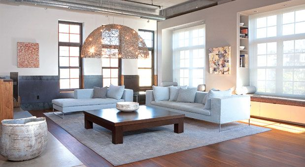 HOME & DESIGN, Urban Chic - A domed light fixture by Brand van Egmond creates a canopy over the main living space.