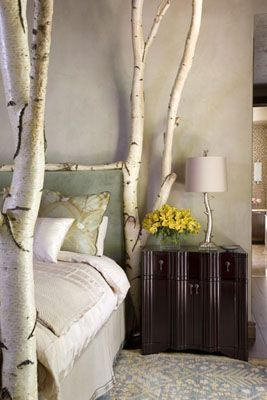 Amazing. Birch tree bed frame cut to fit the room, reaching the peak of the ceiling. Design by Rinfret, Ltd.