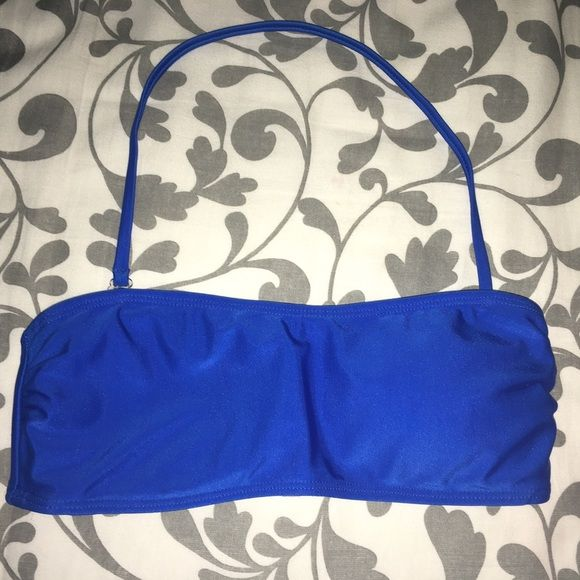 Multi-way Bikini Top This is a multi-way bikini top, it can be worn as a strapless or halter top. Gorgeous Cobalt blue.  Really stretchy and comfortable. Removable lightly lined padding. Forever 21 Swim Bikinis