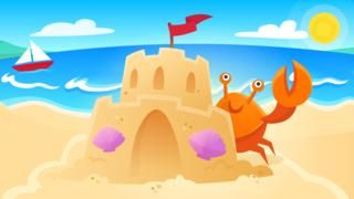 Sandcastle and crab on a beach