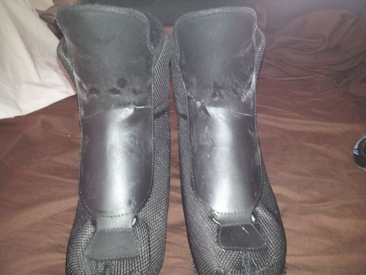 Inline skate boots with cracked, plastic tongues.  Notice they are both cracked in the same place with the same angle.  This cracked plastic can dig into the skaters ankle and cause needless pain and bruising.
