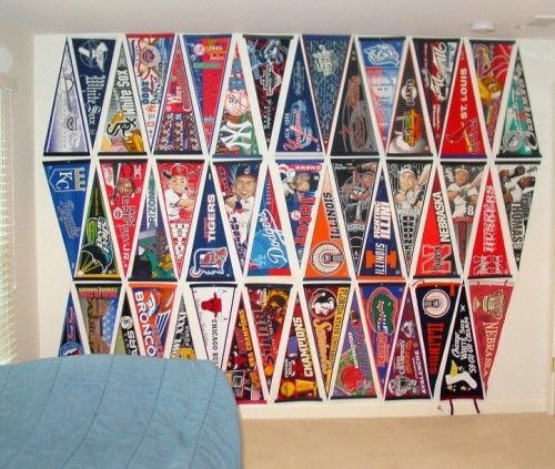 I wouldn't ever have a bunch of baseball pennants hanging in my house (just not that into baseball) but I love the pattern they create.