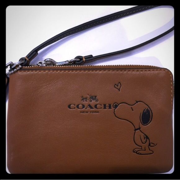 Limited edition Coach Snoopy Wristlet NWT limited edition brown Snoopy wristlet. It has two slots for cards on the inside. Perfect for Valentine's Day, sold out everywhere! Coach Bags Clutches & Wristlets