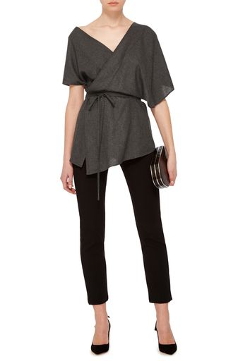 **Hensely** crafted this structured top in a wrapped design evocative of a modernized kimono.
