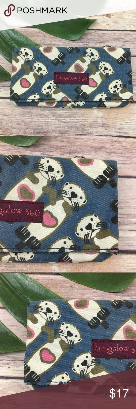 Bungalow 360 sea otter canvas wallet Bungalow 360 blue sea otter print fold over wallet. It is free from any rips or stains but does have some wear to the corners, please see pictures. It measures about 7 inches long, 4 inches tall and is about 1/2 inch deep. bungalow 360 Bags Wallets