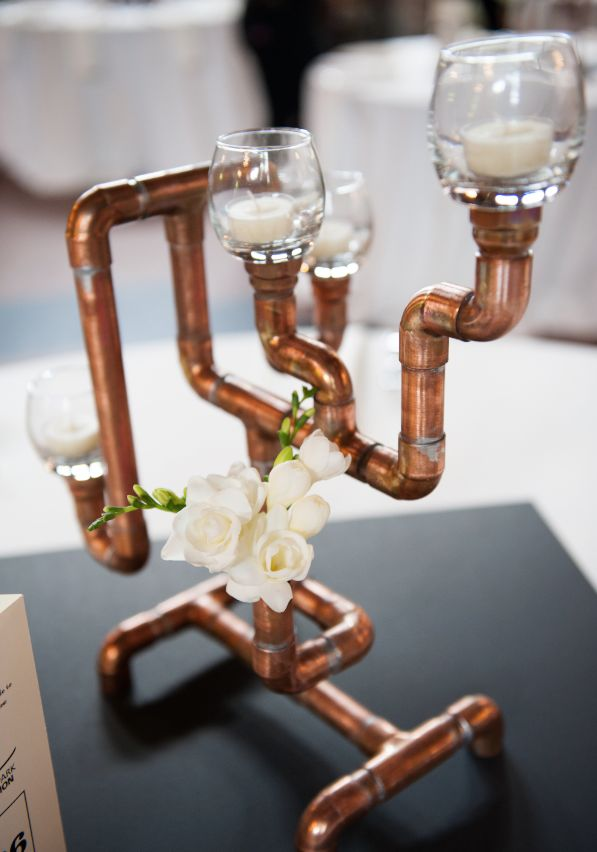 Copper candelabra wedding centrepieces - ideal if you were marrying a plumber!