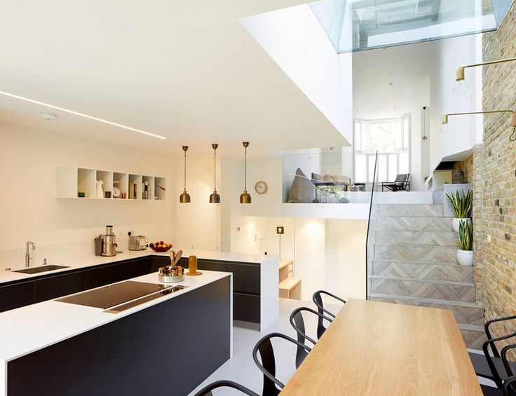 This home in London was renovated into a split-level home to make the space feel more open and modern.