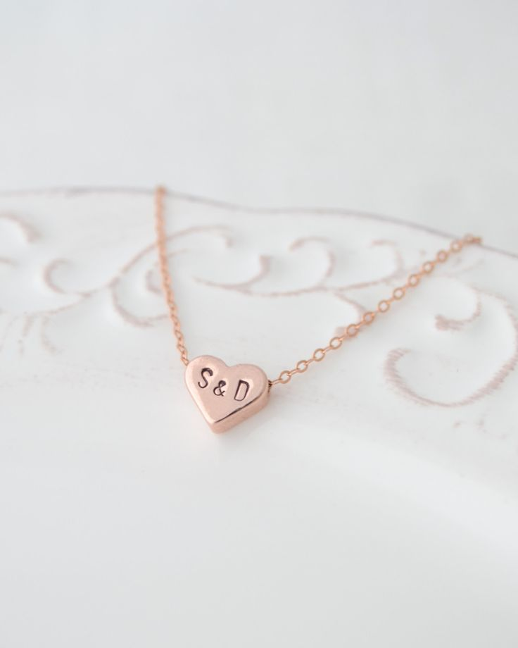 Personalized Love Heart Necklace by Olive Yew. Silver or rose gold heart is hand stamped with the initials of your choice - letter & letter.