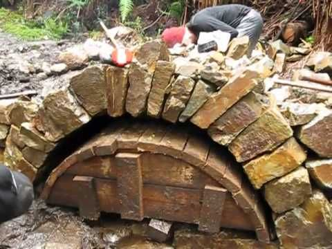 Jens removing the false work from Dry Stone Arch, built in a Dry Stone Retaining Wall. Description from wn.com. I searched for this on bing.com/images
