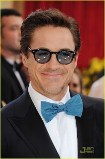 $19.36 Robert Downey not only sported these shades on the red carpet with a bow-tie and running shoes, but he kept them on for his award presentation later in the show. This fine pair of sunglasses is Sheldrake by Oliver Peoples. What do you think about wearing these while presenting an award? Too much?