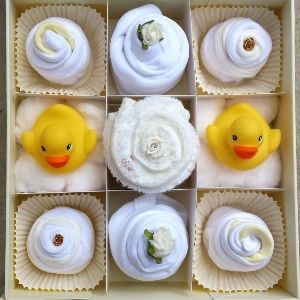 The perfect gift that stands out amongst the rest Cute cupcakes made from real baby clothes presented in a beautiful keepsake box Contents include x1
