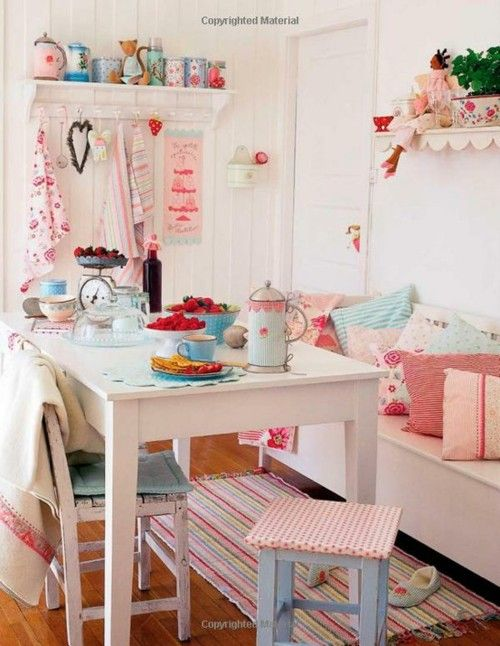 white room with red and duck egg blue accessories - this room is full of fun, but the white background handles it well